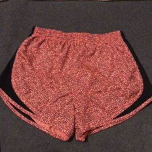 Pink and black Nike athletic shorts